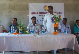 Discussion with local village leaders about Health ATM in rural Orissa, India 2010